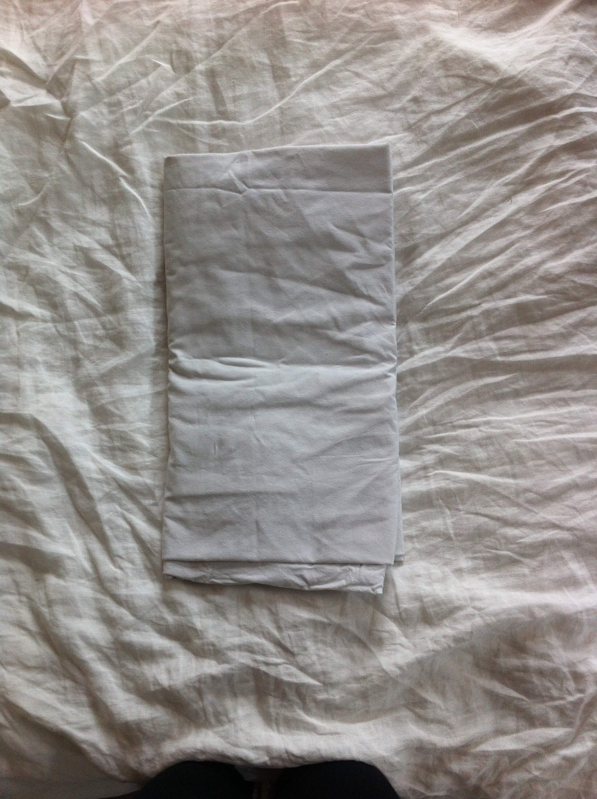 How to fold a fitted sheet Step 6